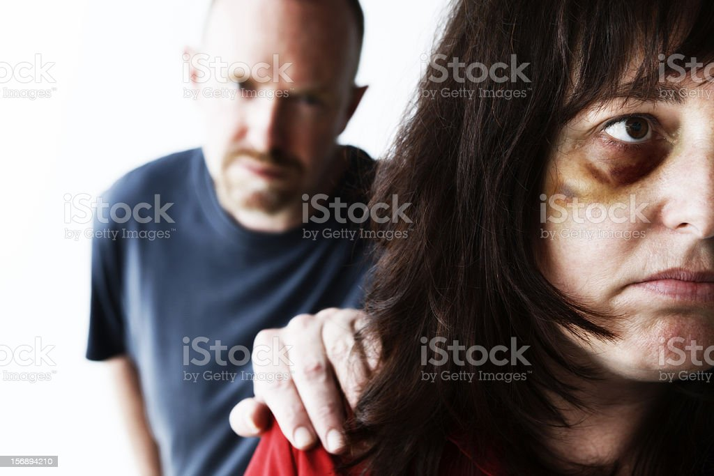 Abuser tries to stop woman getting away stock photo