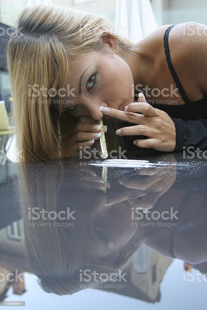 Abusing drugs royalty-free stock photo