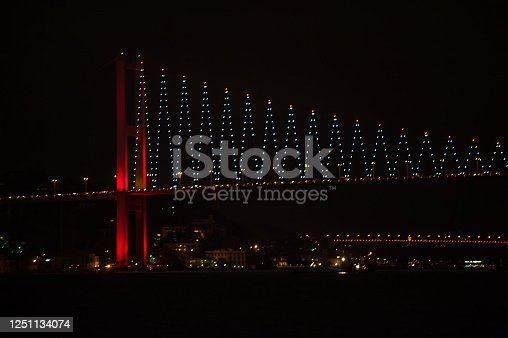 Landscape of Bosphorus bridge at the night with red led lights