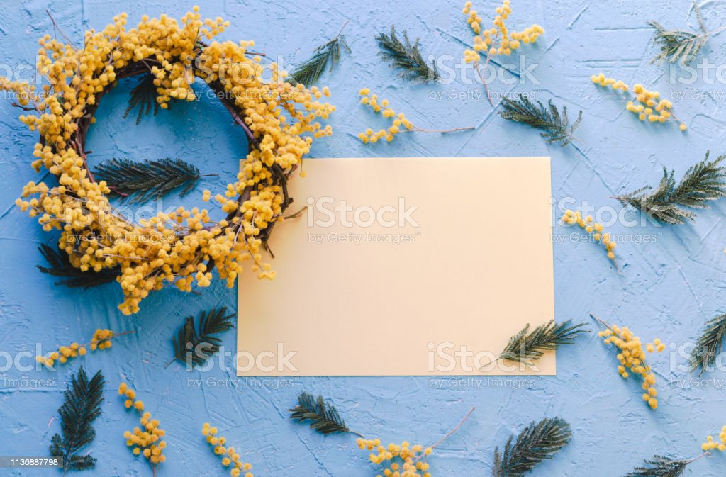 Acacia flower wreath with space to copy on card. Flat lay. Top view.