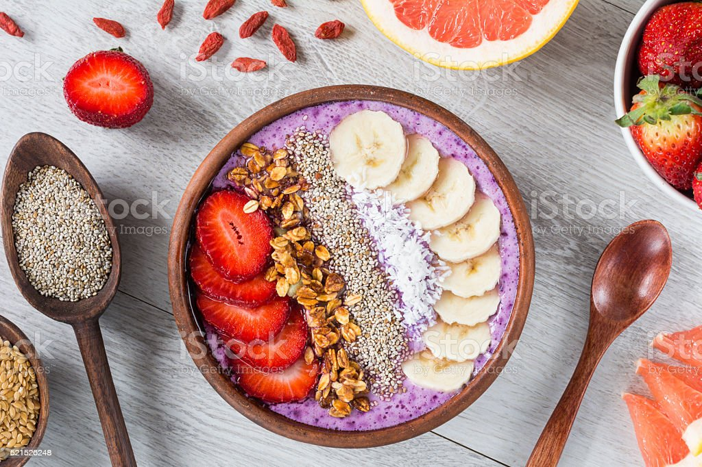 Acai berry smoothie bowl with superfoods and fruits stock photo