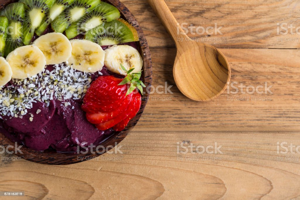 Acai bowl and wooden spoon stock photo