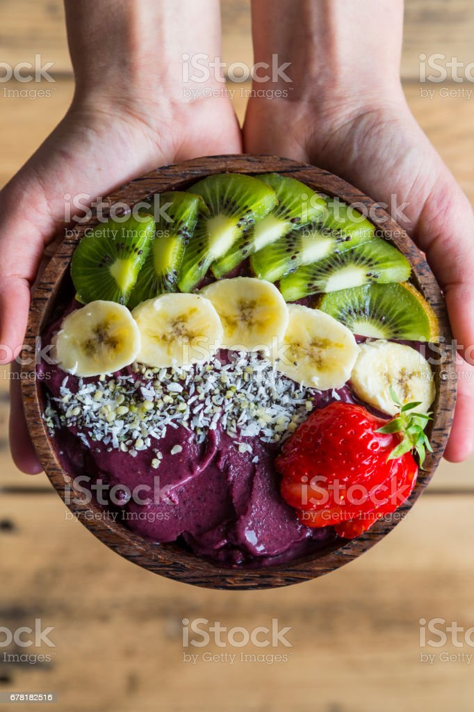 Acai bowl in hands stock photo