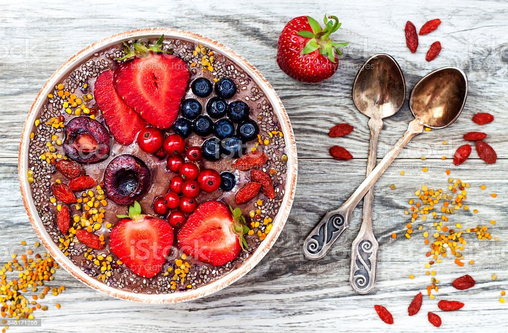 Acai breakfast superfoods smoothies bowl with chia seeds, pollen, goji stock photo
