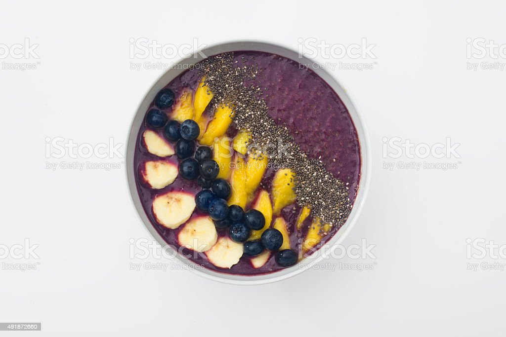 acai smoothie bowl with chia seeds, mango, blueberries and bananas stock photo