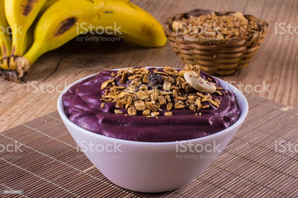 Acai with banana and granola stock photo