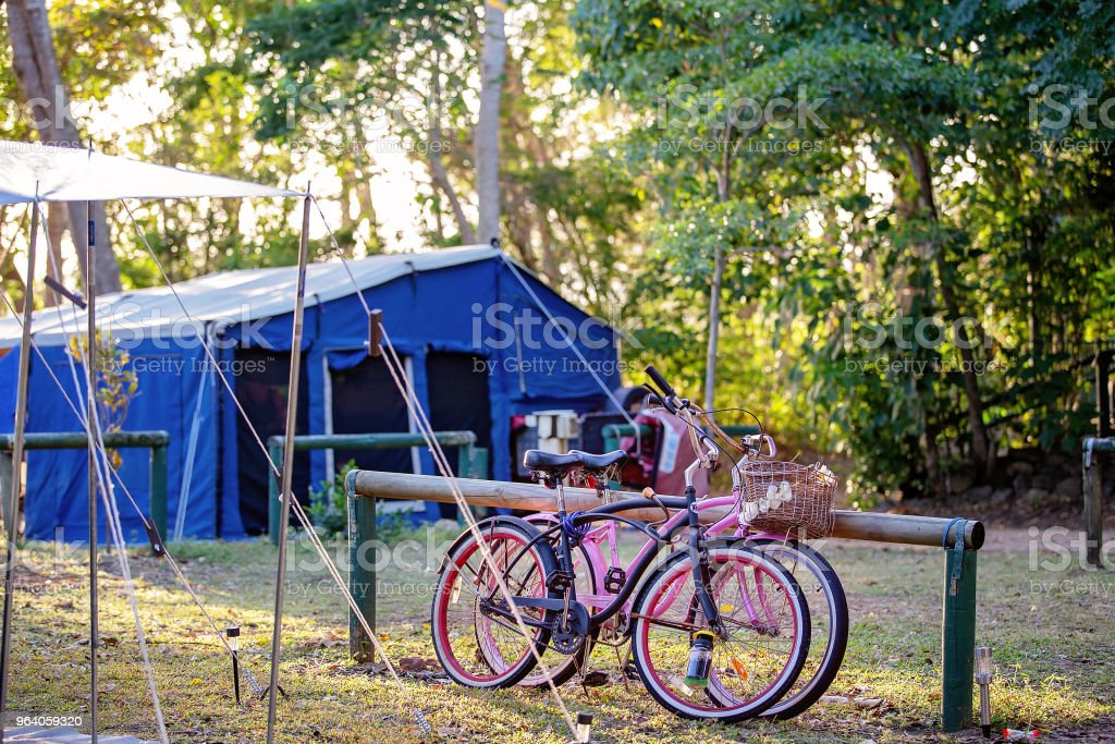 ACampsite In The Bush With Children's Bicycles Leaning Against A Post - Royalty-free Australia Stock Photo