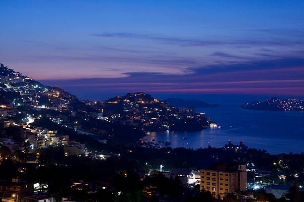 acapulco at sunset stock photo