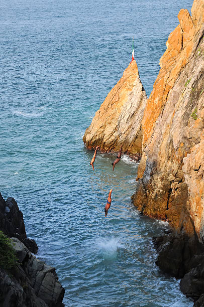 Acapulco cliffs divers stock photo