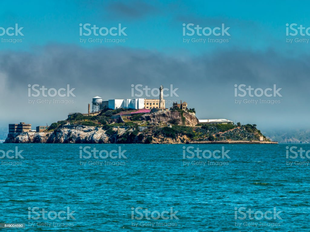 Acatraz prison under fog stock photo
