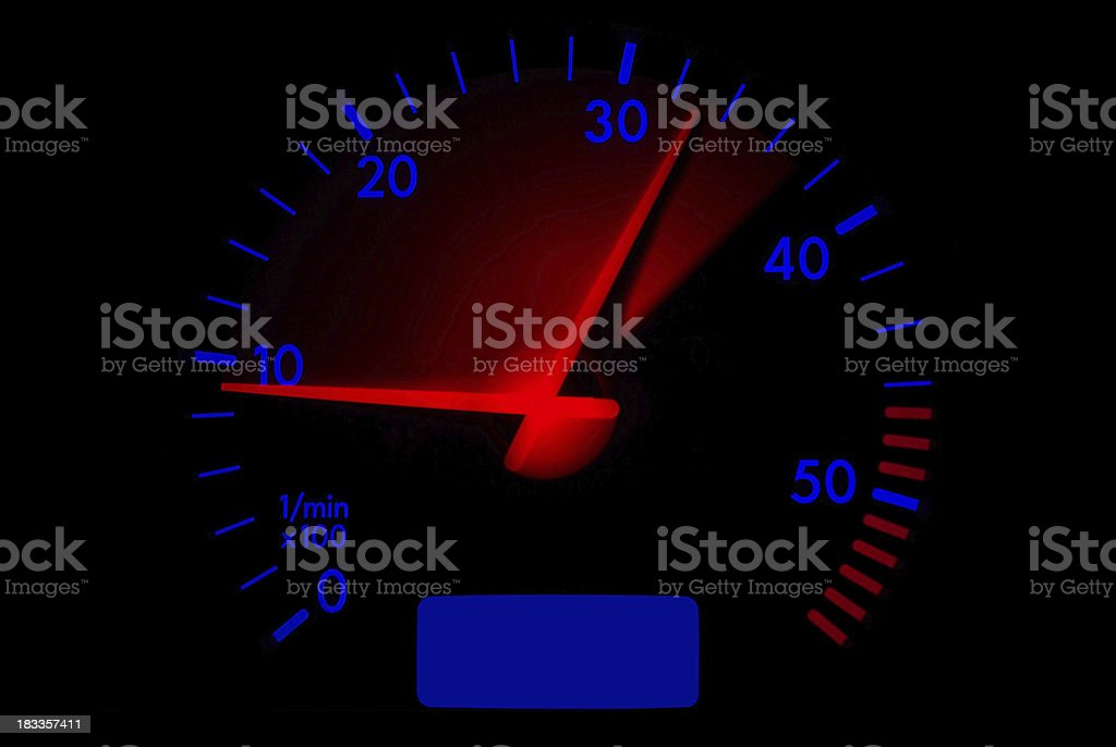 Accelerating and decelerating tachometer stock photo