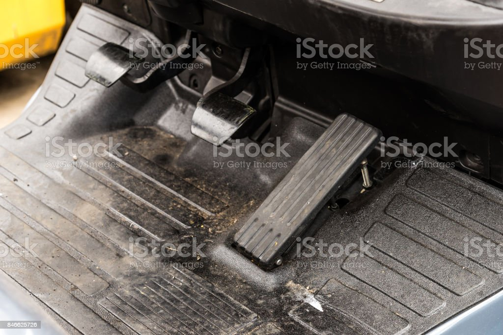 Acceleration, clutch and break pedals in forklift truck stock photo