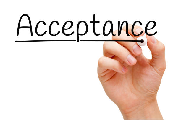 Acceptance Handwritten With Black Marker Hand writing Acceptance with black marker on transparent wipe board isolated on white. approbation stock pictures, royalty-free photos & images