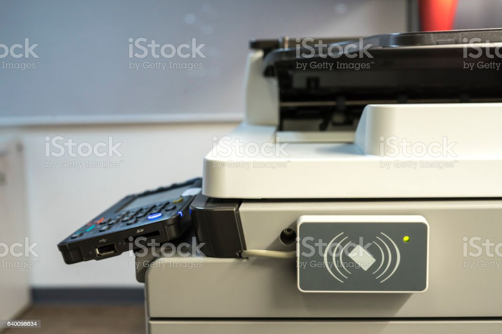 access control for scanning key card to access  Photocopier. stock photo
