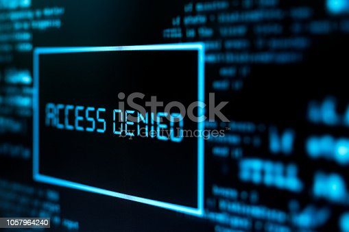 Photography of motinor screen with inscription Access denied. Cybercrime concept.
