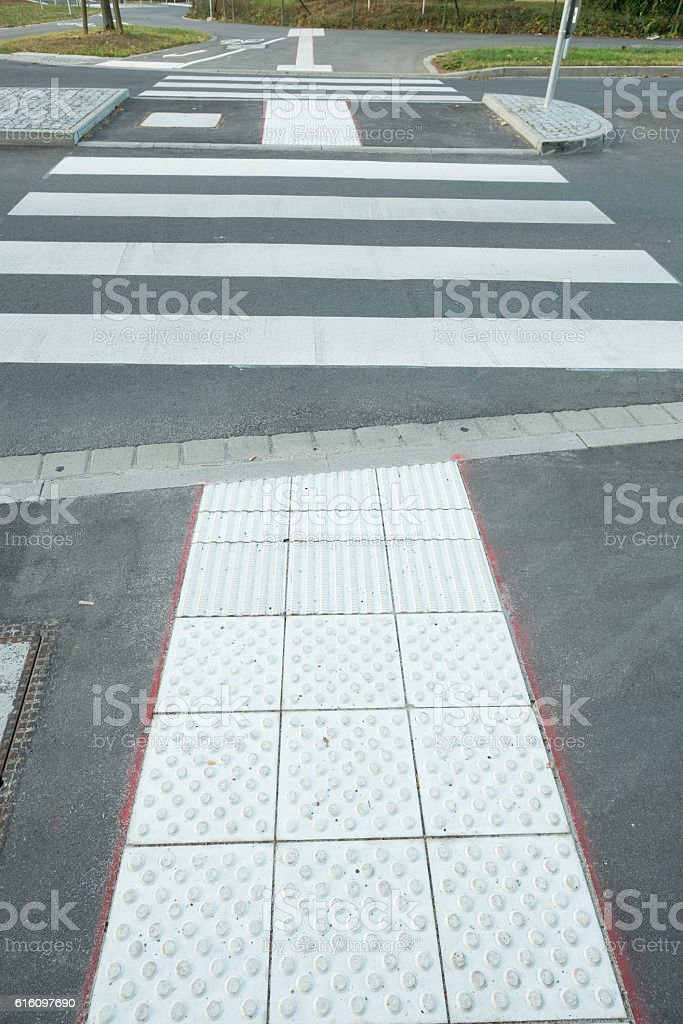 Accessible attention field at a zebra crossing stock photo
