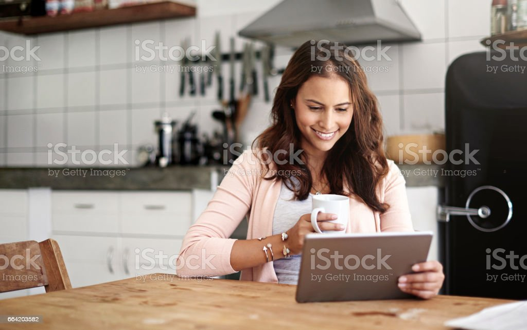 Accessing the web where she feels most at home stock photo