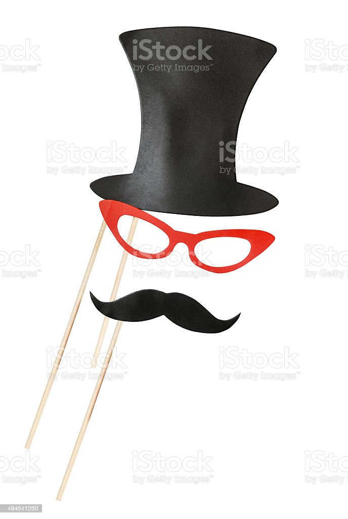 accessories for a fun holiday of paper, lips, mustaches, hats stock photo