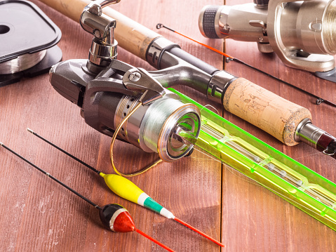 istock Accessories for fishing on the wooden background, 1128939971