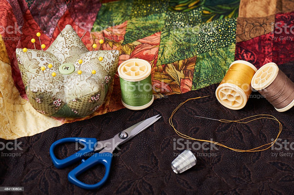 Accessories for patchwork on a quilt stock photo
