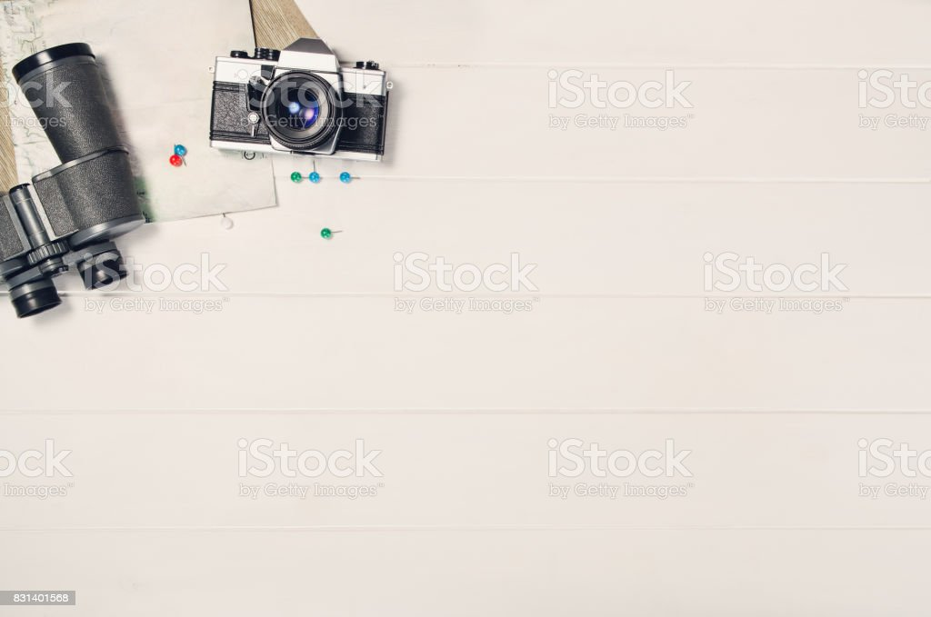 Accessories for travel top view on white wooden background frame