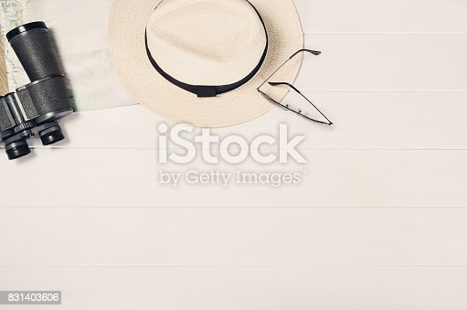 istock Accessories for travel top view on white wooden background frame 831403606
