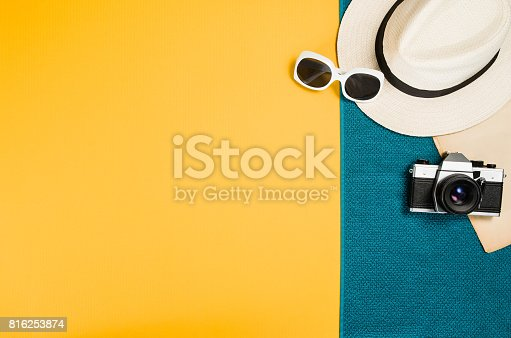 istock Accessories for travel top view yellow background with copy space 816253874