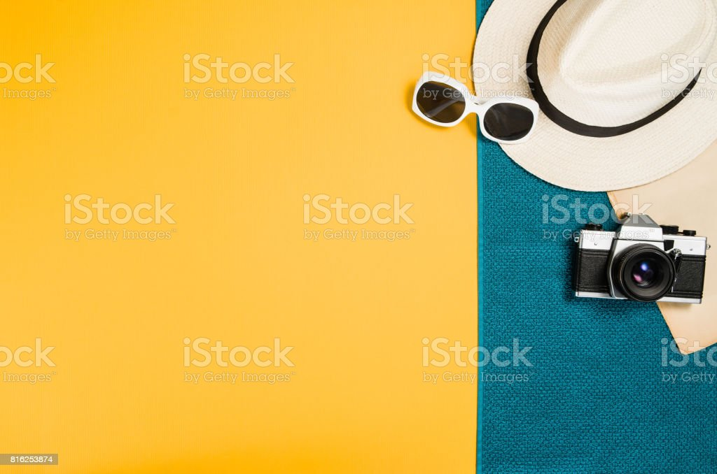 Accessories for travel top view yellow background with copy space stock photo