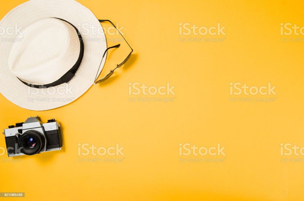 Accessories for travel top view yellow background with copy space royalty-free stock photo