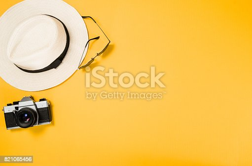 istock Accessories for travel top view yellow background with copy space 821065456