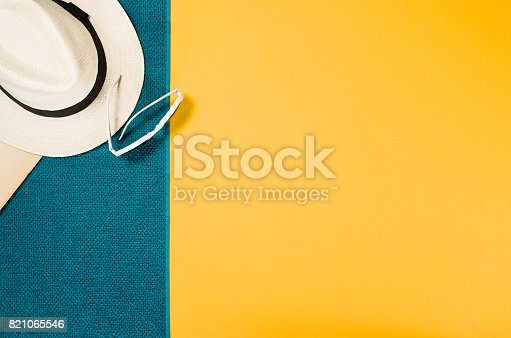 istock Accessories for travel top view yellow background with copy space 821065546