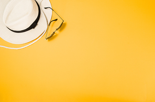 istock Accessories for travel top view yellow background with copy space 827299442