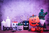 istock Accessories of decorations Happy Halloween day background concept.Cup of drink with pumpkin object to party season with spider on modern rustic brown & stone backdrop at home office desk studio. 1178690801