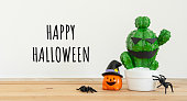 istock Accessories of decorations Happy Halloween day background concept.Jack O Lanterns cactus with spooky pumpkins object to party season with spider on modern rustic brown & white stone backdrop. 1178690936