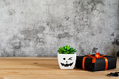 istock Accessories of decorations Happy Halloween day background concept.Jack O Lanterns cactus  spooky pumpkins object to party season with gift box on modern rustic brown & white stone backdrop.copy space 1179502277