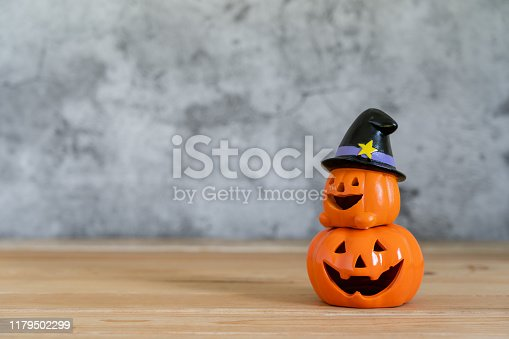 Accessories of decorations Happy Halloween day background concept.Couple jack O Lanterns with spooky pumpkins object to party season  on modern  brown & white stone backdrop.copy space for creative.