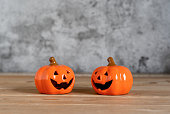 istock Accessories of decorations Happy Halloween day background concept.Couple jack O Lanterns with spooky pumpkins object to party season  on modern  brown & white stone backdrop.copy space for creative. 1179502302