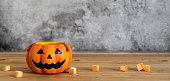 istock Accessories of decorations Happy Halloween day background concept.Couple jack O Lanterns with spooky pumpkins and candy object to party season  on modern  brown & white stone backdrop.copy space. 1180966935