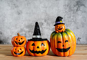 istock Accessories of decorations Happy Halloween day background concept.Variety of Jack O Lanterns pumpkins object to party season with spider on modern rustic brown & white stone backdrop.copy space. 1179502335