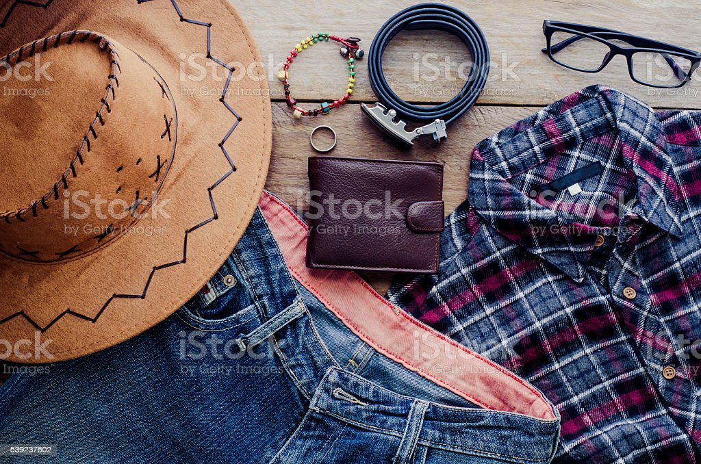 accessory for men, placed on a wooden floor. royalty-free stock photo