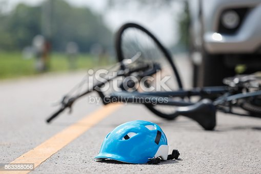 istock Accident car crash with bicycle on road 863388056