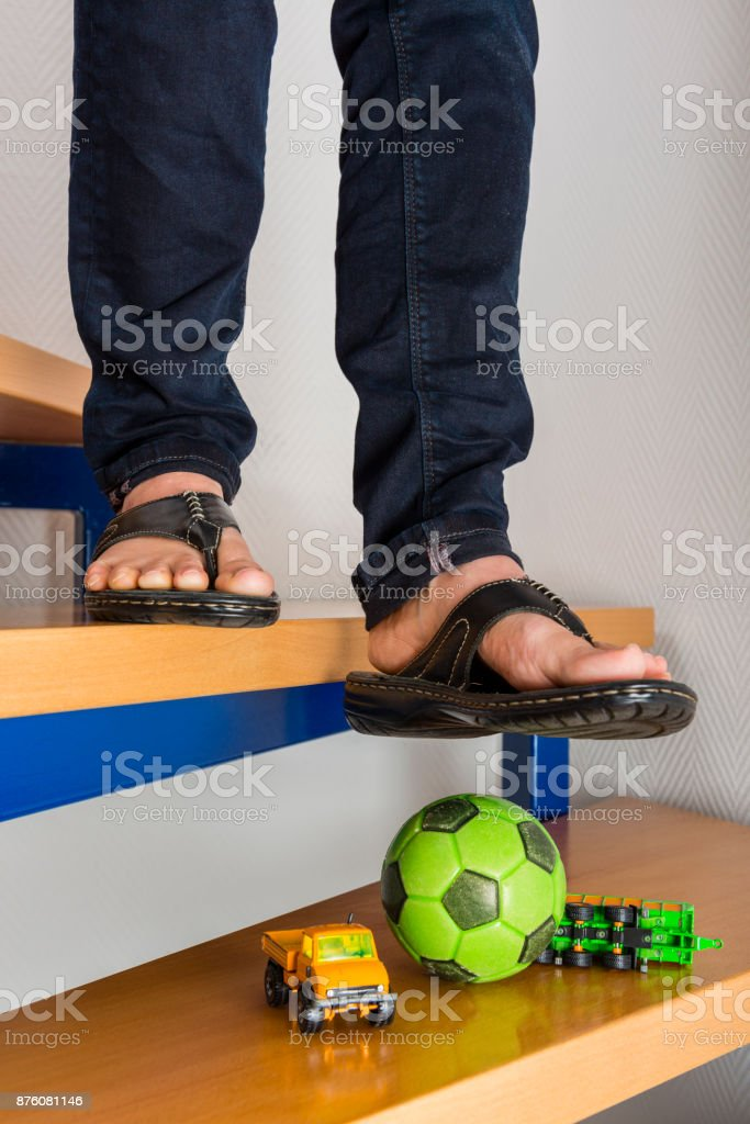 Accident - child falling down the stairs at home stock photo