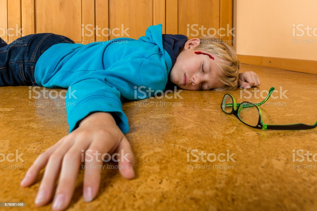Accident - child falling from a ladder at home stock photo
