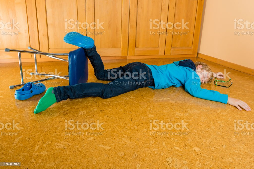 Accident - child falling from a stool stock photo