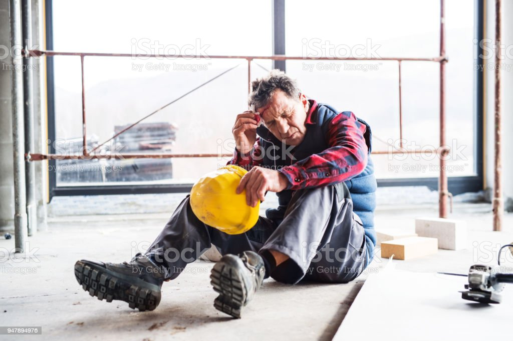 Accident of a man worker at the construction site. stock photo
