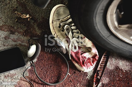 istock Accident on the road, Car crash, Blood body lying on the street hit by a car. 868481164