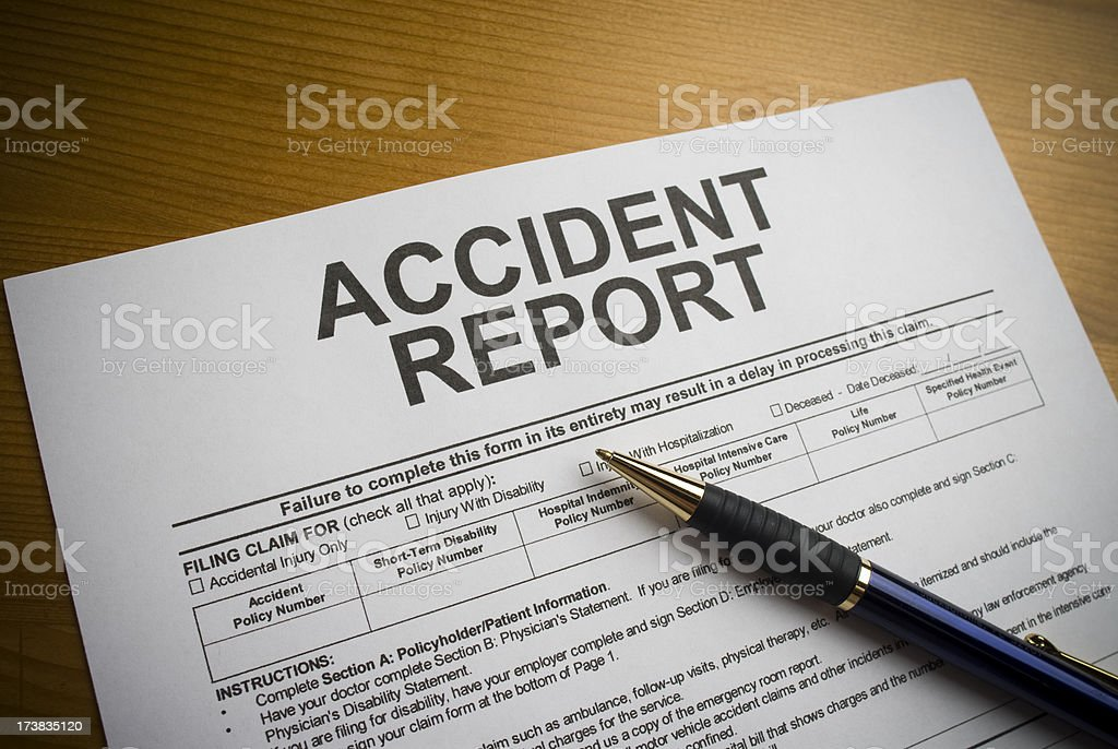 Accident report form on a desk with a pen royalty-free stock photo