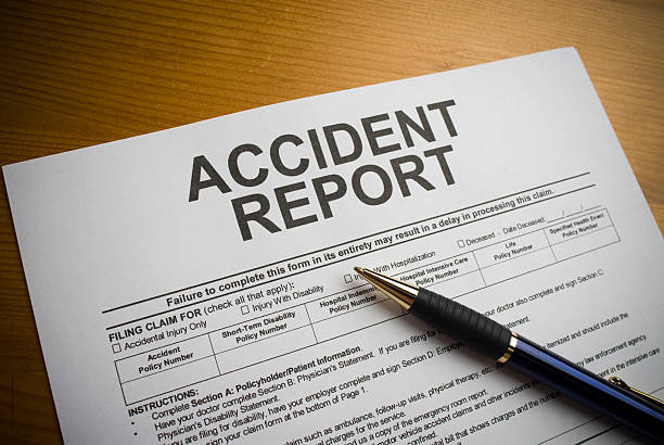 Accident report form on a desk with a pen stock photo