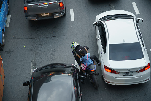 Bangkok, Thailand - September 14, 2018: Accident scene of a motorbike tries to pass between vehicles stand in a traffic jam after work on Ratchadamri Rd.