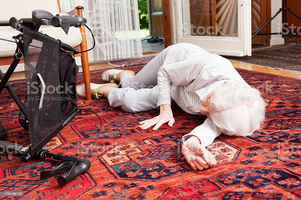 accident senior woman after fall lying on ground royalty-free stock photo